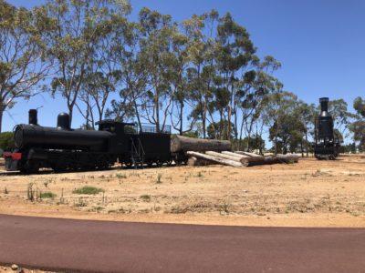 static display of locomotive train on rail line