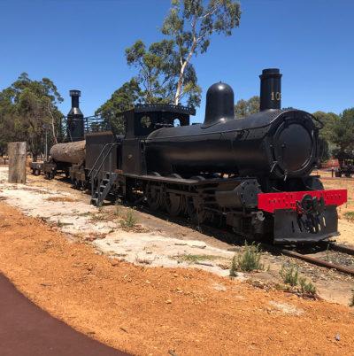 static display of locomotive on railway