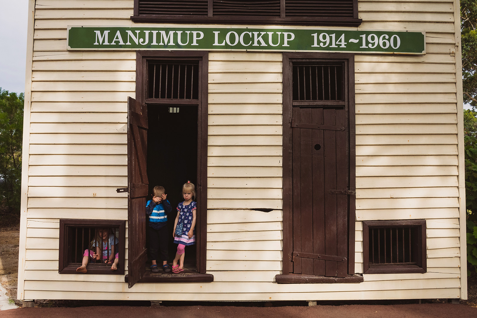 children looking sad in the manjimup lock up building