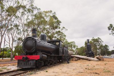 locomotive train and steam hauler static display on train tracks