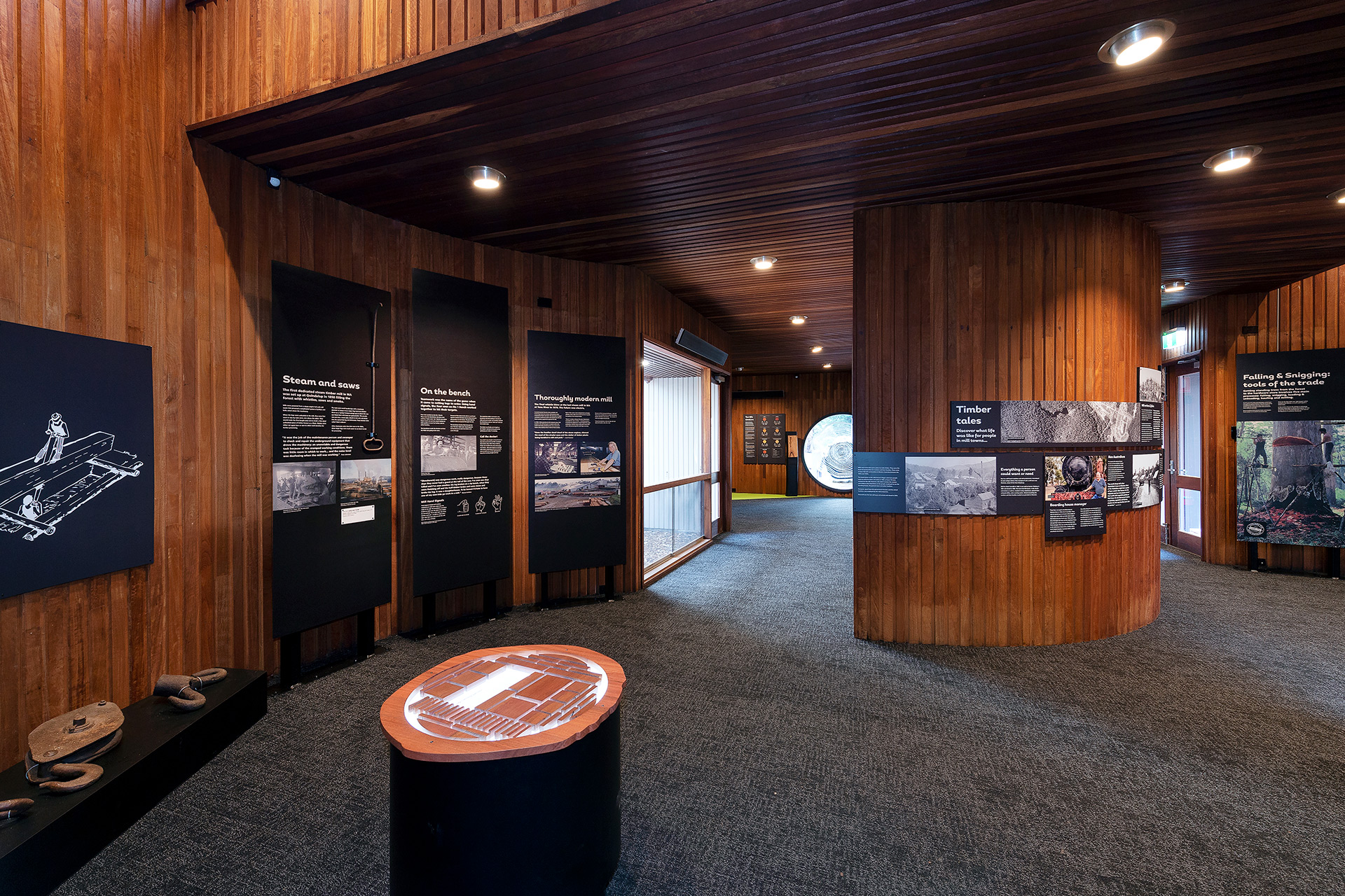 wide shot of inside timber museum with interpretative signage and museum objects