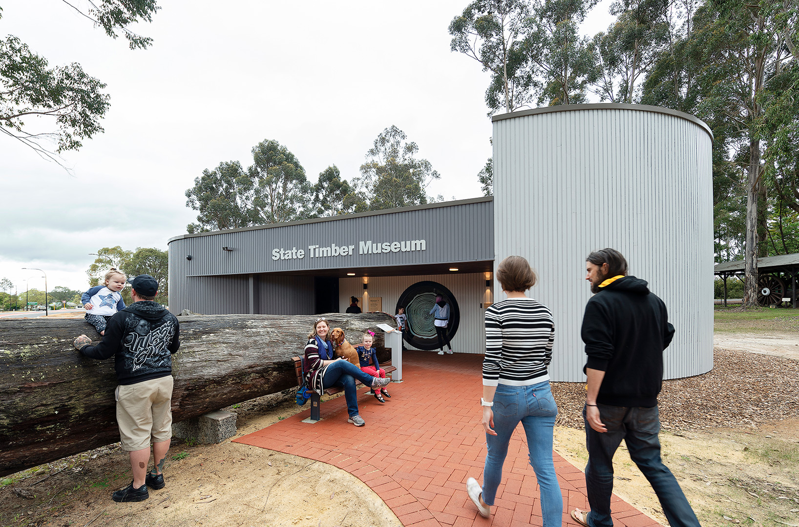 people entering the timber museum