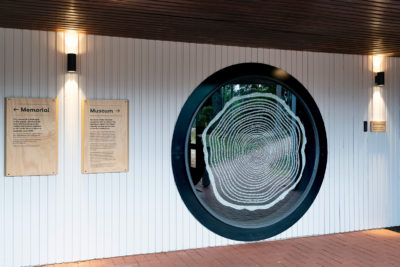 enter of timber museum featuring large circular window with artwork on it