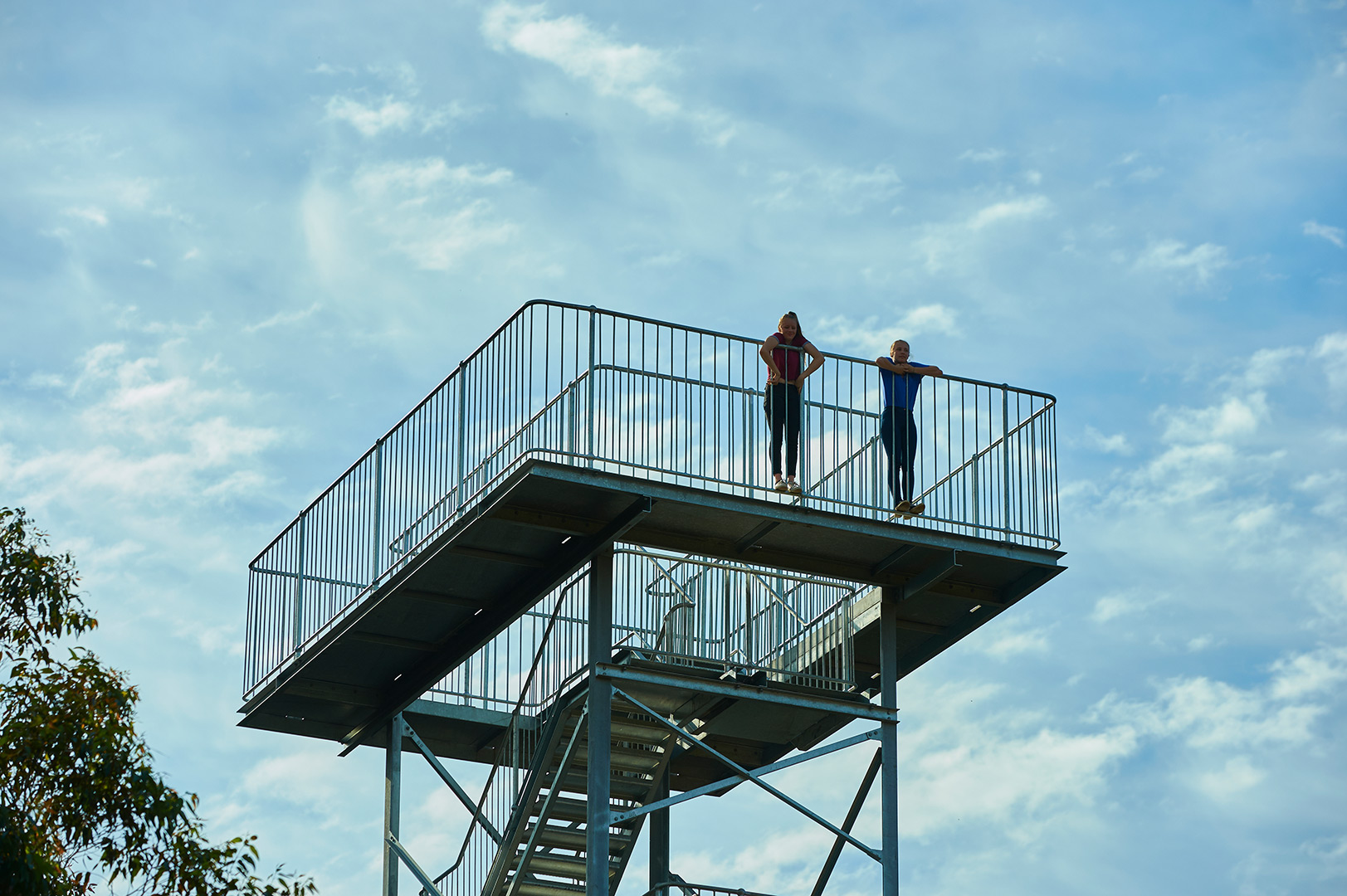 youth on top of lookout tower
